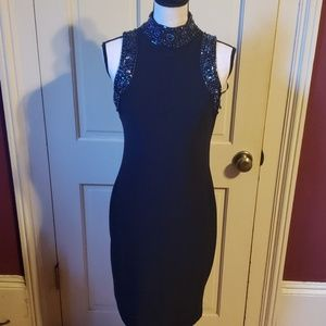 Gorgeous black dress with beaded neck 6